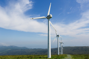 Onshore wind farm - large wind turbines in a row