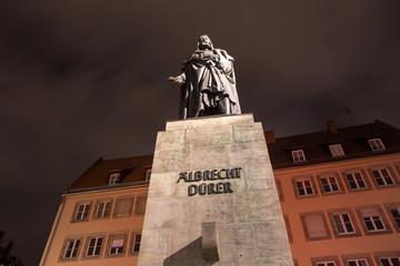 albrecht duerer statue nuernberg at night