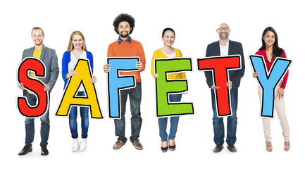 Diverse Group of People Holding Text Safety