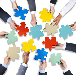 Group of Business Hands Holding Jigsaw Puzzles