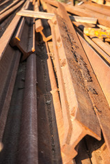 Stack of railway tracks. Old rusted rails