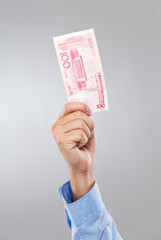 Businessman hand hold with hundred RMB