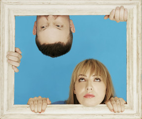 White Couple Behind Wooden Frame