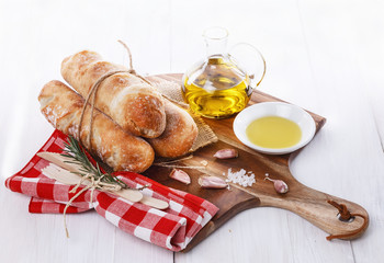 Freshly baked bread rolls and oil