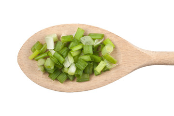 Chopped spring onion on wooden spoon isolated on white