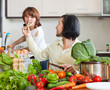 Happy couple preparing vegetable salad