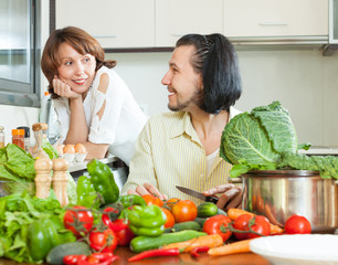The couple preparing a meal of vegetables