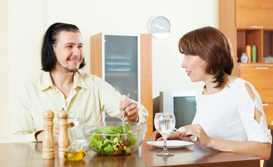 Man and woman eating vegetables