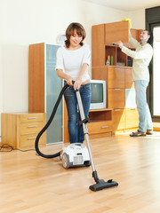 friendly couple  doing housework together