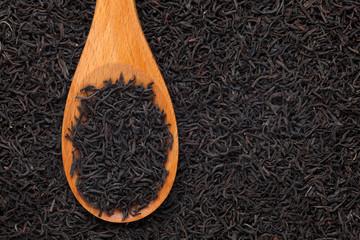 Black tea in a wooden spoon