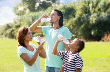 parents with teenager  drinking clean water