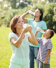 ordinary family of three drinking water