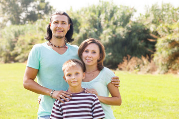 Portrait of adult couple with teenage son