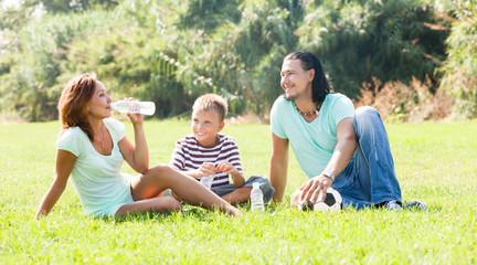 Smiling family  in sunny park