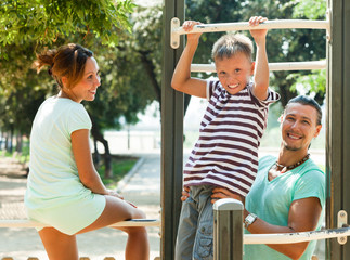 Family on pull-up bar
