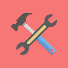 wrench and hammer on red background