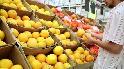 Customers In Huge Retail Supermarket