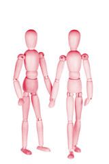Two pink wooden little people, homosexual couple