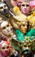 Various carnival masks of different color