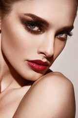 Beautiful young model with red lips Gorgeous Woman Face.