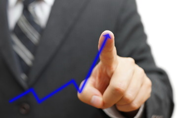 businessman touching growing arrow. Positive trend concept