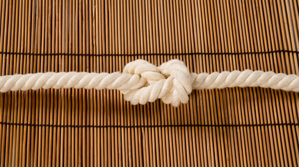 rope with a knot on a background of straw