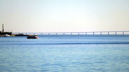 Ferry Crosses the Bay to the background of the Bridge, timelapse