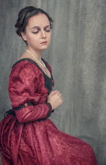 Sad beautiful woman in medieval dress