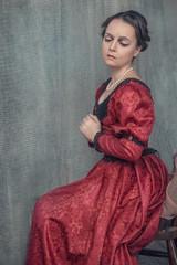 Sad beautiful woman in medieval dress