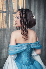 Beautiful medieval woman in blue dress