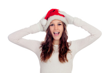 Surprised casual girl with Christmas hat