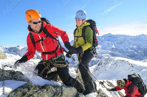 canvas print picture Teamwork im Hochgebirge