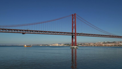 Panoramic View on the 25 de Abril Bridge in Lisbon, Portugal.