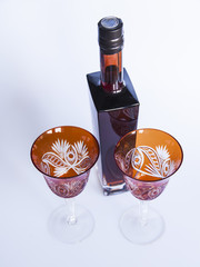 Vintage red glasses for wine and a bottle with wine