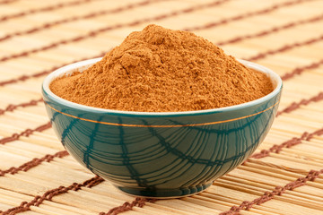 Ground cinnamon in bowl