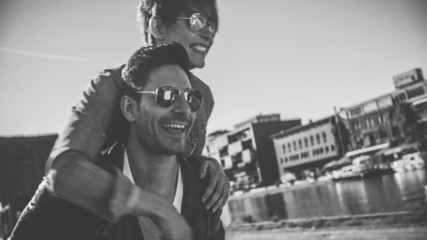 Cool couple piggyback, black and white