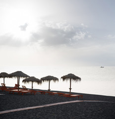 Beach of black sand under morning sun