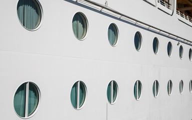 Lines of Portholes on White Bulkhead