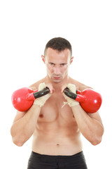 man holding red kettlebells weights lifted and looking at the c