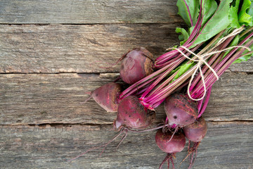 fresh beet on wooden surface