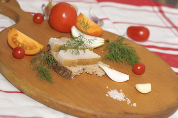 Sandwich with salted lard, onion and tomatoes