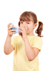 little girl using an asthma inhaler