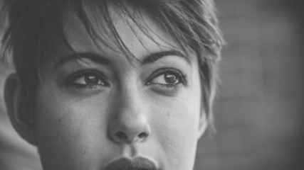Black and white close up of young woman's face
