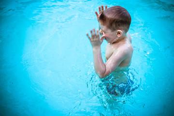 Child Enjoying Swimming in a Pool