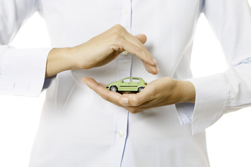 hands holding a miniature car