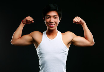 Handsome fit asian man on black background
