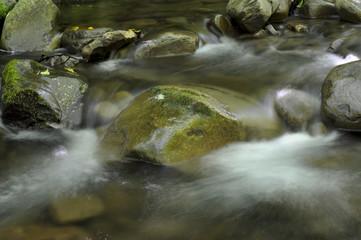 Water flowing between stones