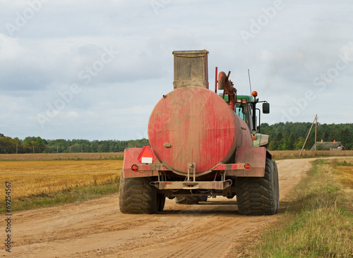 Tractor on the field. - 69254567