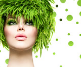 Beauty woman with fresh green grass hair. Nature model girl