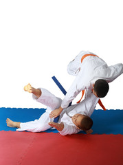 Judo throw in execution athlete with an orange belt